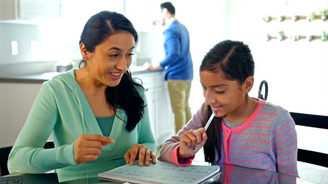 mother helping her young daughter with math homework at kitchen table - homework stock videos & royalty-free footage