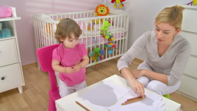 hd crane: mother helping his daughter to draw - crane shot stock videos & royalty-free footage