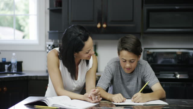 mother helping son with homework - homework stock videos & royalty-free footage