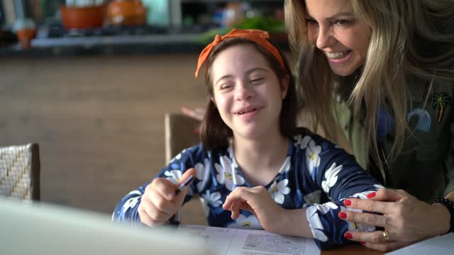 mother helping special needs daughter studying at home - intellectual disability stock videos & royalty-free footage