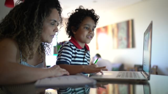 mother helping young son with homework at home - one parent stock videos & royalty-free footage