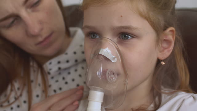 mother helps daughter make inhalation - cystic fibrosis stock videos & royalty-free footage
