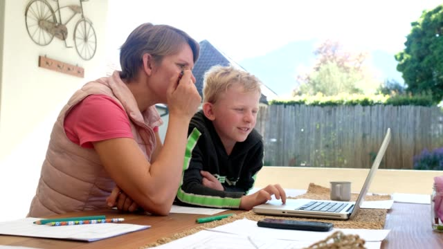 mother helps her son with school work - stay at home order stock videos & royalty-free footage
