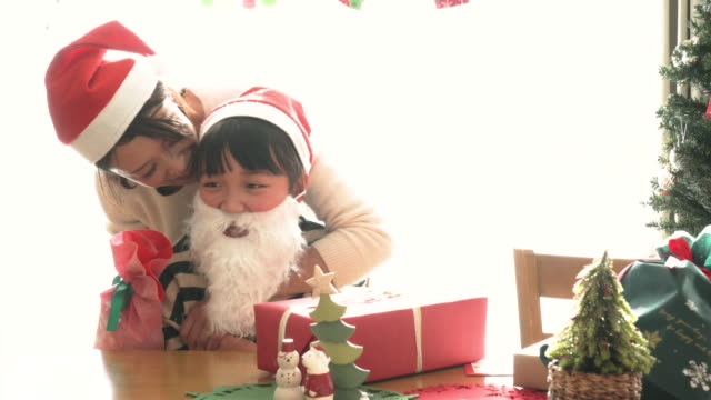a mother holding a daughter at christmas party - physical stance stock videos & royalty-free footage