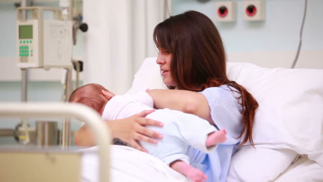 mother holding a new born baby - examination gown stock videos and b-roll footage