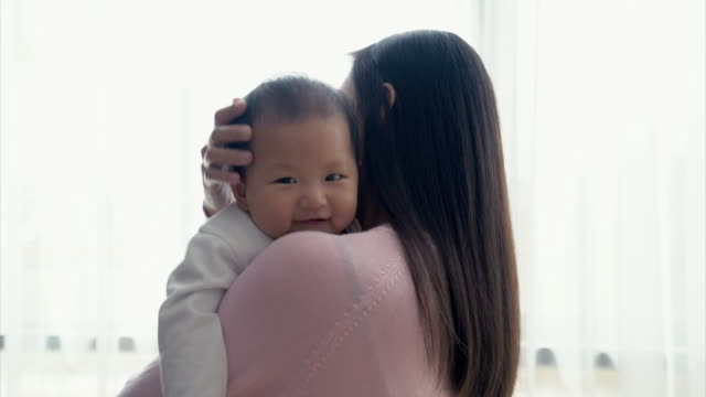 cu mother holding her baby at home - cardigan sweater stock videos & royalty-free footage