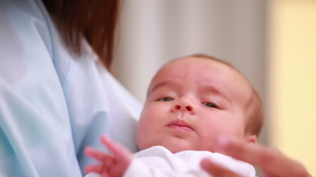 mother holding her new born - examination gown stock videos & royalty-free footage