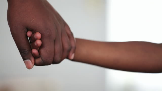 mother holds her daughters hand - african ethnicity stock videos & royalty-free footage