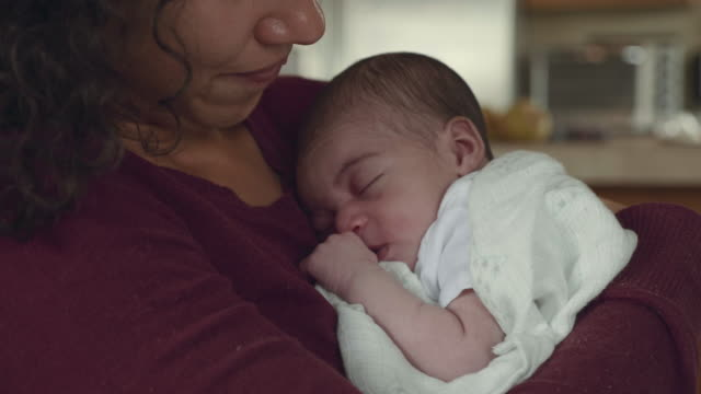 mother holds newborn infant in her arms - newborn stock videos & royalty-free footage