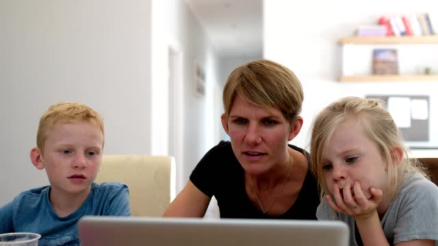 mother home schooling her children - child stock videos & royalty-free footage