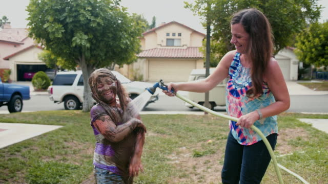 mother hoses down muddy daughter - hose stock videos and b-roll footage