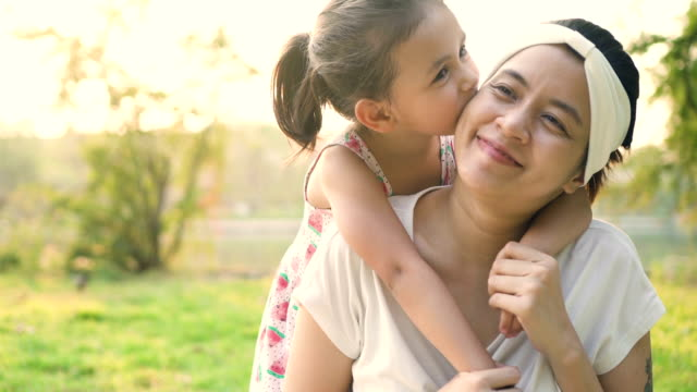 mother hugging and kissing girl - mother and daughter making out stock videos & royalty-free footage