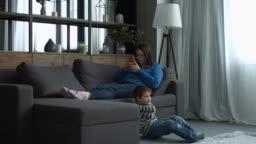 Mother ignoring her little boy in the bedroom