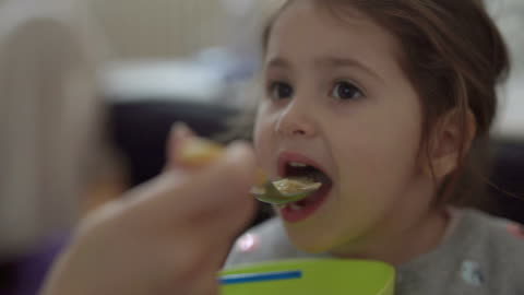 mother is feeding her 3 year old girl with soup - soup stock videos & royalty-free footage