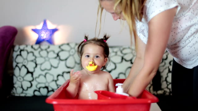 mother is soap her baby girl - washtub stock videos and b-roll footage