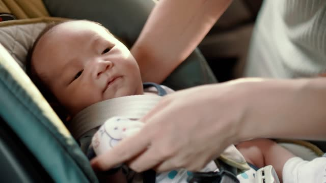 cu : mother is taking car seat belt for her son - vehicle seat stock videos & royalty-free footage