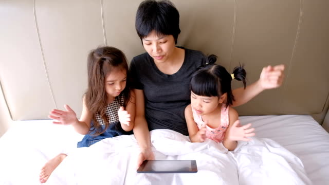 Mother is using digital tablet with her daughter