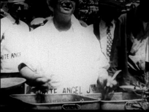 mother jordan serving food quickly with both hands at soup kitchen / san francisco - 1931 stock videos & royalty-free footage