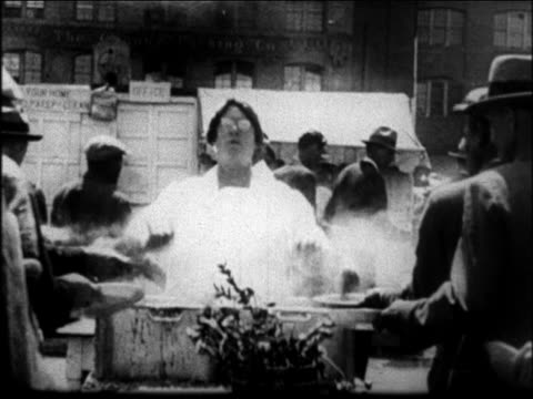 mother jordan serving food to men quickly at outdoor soup kitchen / san francisco - 1931 stock videos & royalty-free footage