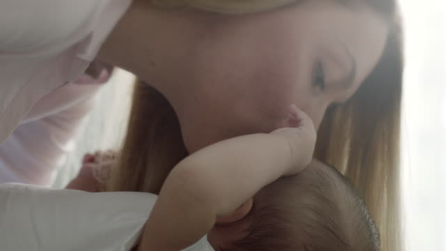 mother kissing baby in forehead - forehead stock videos and b-roll footage