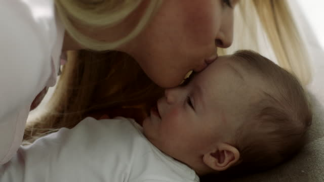 mother kissing baby - forehead stock videos and b-roll footage