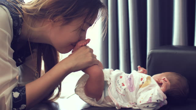 mother kissing little babies feet - innocence stock videos & royalty-free footage