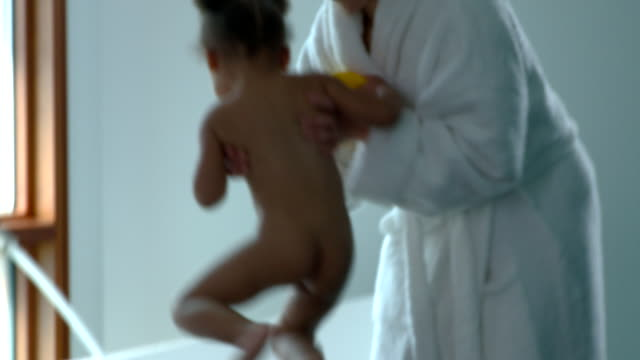 MS TU TD Mother lifting naked girl into bathtub / Richmond, Virginia, USA