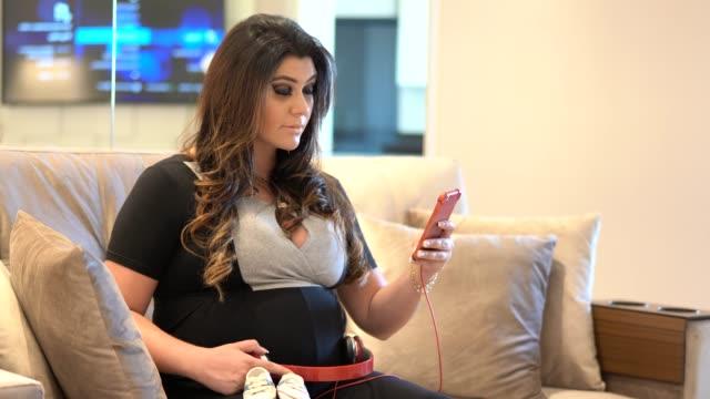 mother listening her child - bambine femmine video stock e b–roll
