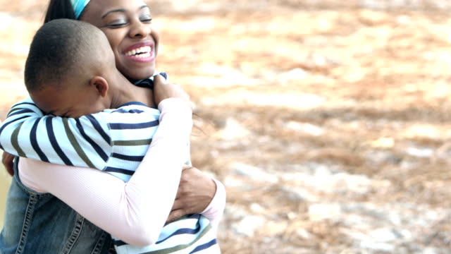 mother, little boy talking, hugging - son stock videos & royalty-free footage