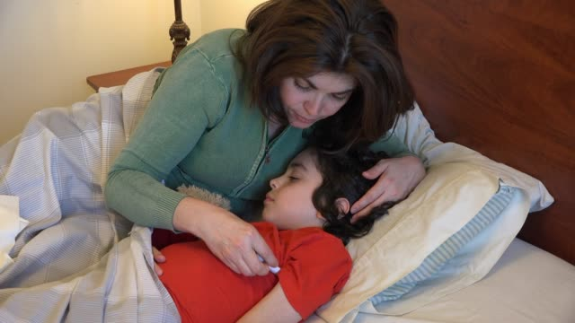 mother looking after a sick child - thermometer stock videos & royalty-free footage