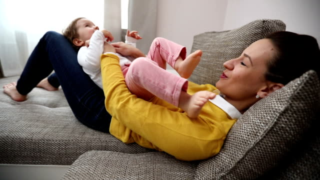 mother loves her baby - kids feet tickle stock videos & royalty-free footage