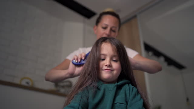 mother making a hairstyle for her little girl - brushing hair stock videos & royalty-free footage