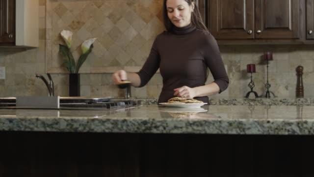 ms tu mother making cookies in kitchen, daughter (9-10) stealing one / orem, utah, usa - orem utah stock videos & royalty-free footage