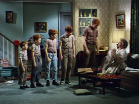 1962 mother making group of redheaded boys remove pants in living room / industrial - conformity stock videos & royalty-free footage