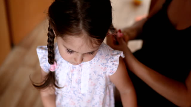 mother making her daughter's hair - braided hair stock videos & royalty-free footage