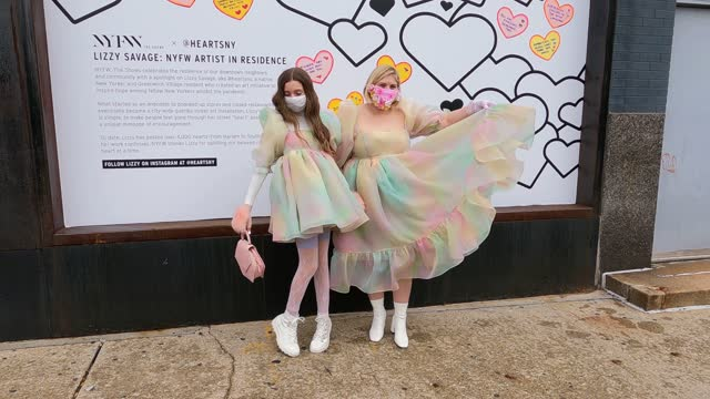 mother michelle blashka and daughter ella sophie blashka wearing matching pastel-colored dresses dance outside new york fashion week at spring... - ニューヨークファッションウィーク点の映像素材/bロール