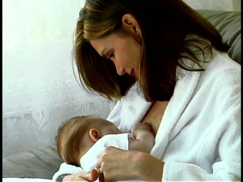mother nursing baby - unknown gender stock videos & royalty-free footage