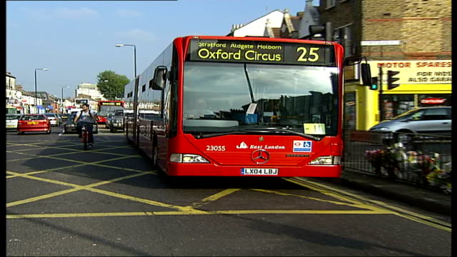 mother of man who died under wheels of bendy bus calls for ban; england: london: ilford: ext bendy bus along street in spot where lee beckwith was... - ilford stock videos & royalty-free footage