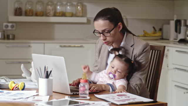 mother of naughty baby working from home - multitasking phone stock videos & royalty-free footage