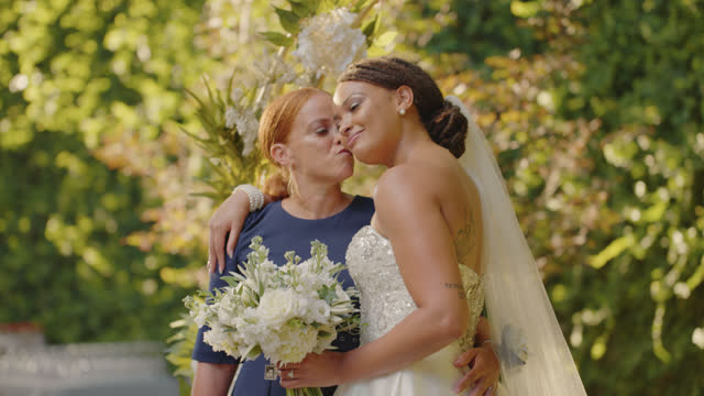 mother of the bride kisses her daughter during a portrait session - eternity stock videos & royalty-free footage
