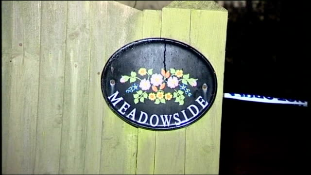 Father gives evidence 2712010 East Sussex Heathfield Police outside house 'Meadowside' sign police along from house and 'Road closed' signs at end of...