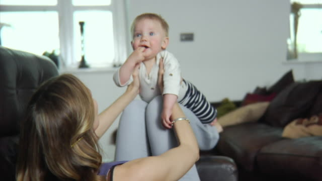 slo mo ms mother playing with baby boy (6-11 months) / london, united kingdom - see other clips from this shoot 1518 stock videos & royalty-free footage