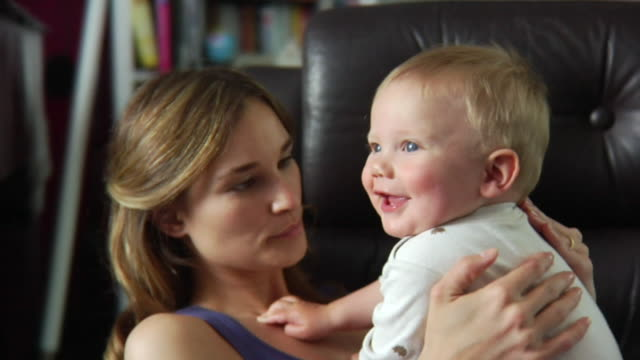 slo mo cu mother playing with baby boy (6-11 months) / london, united kingdom - mutter stock-videos und b-roll-filmmaterial