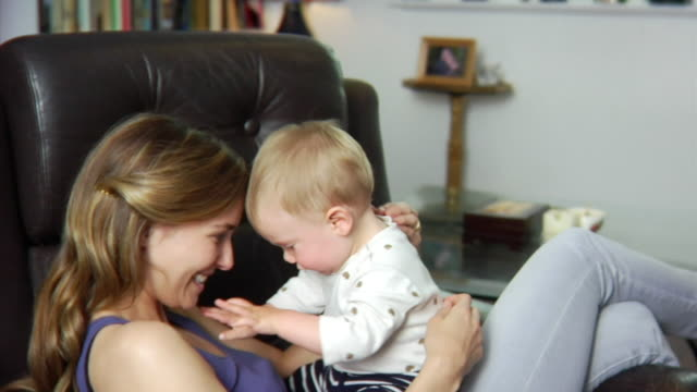 SLO MO MS PAN Mother playing with baby boy (6-11 months) / London, United Kingdom