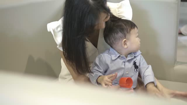 mother playing with baby boy (6-11 months) - 6 11 months stock videos & royalty-free footage