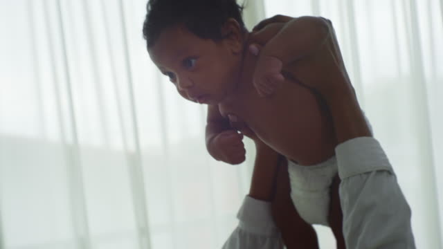 mother playing with her adorable baby - nappy stock videos & royalty-free footage
