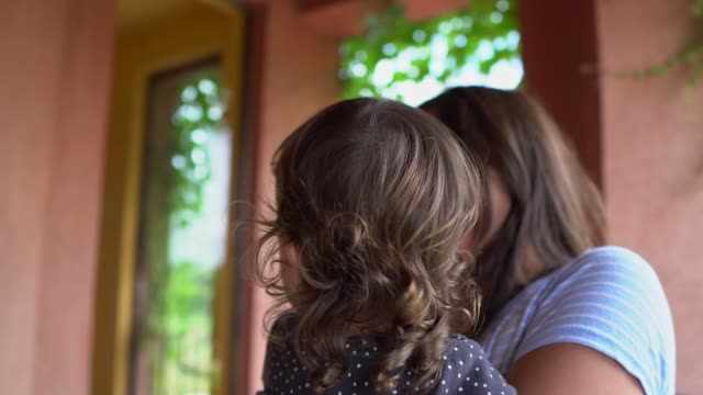 mutter spielt mit ihrem baby in den armen - kindertag stock-videos und b-roll-filmmaterial
