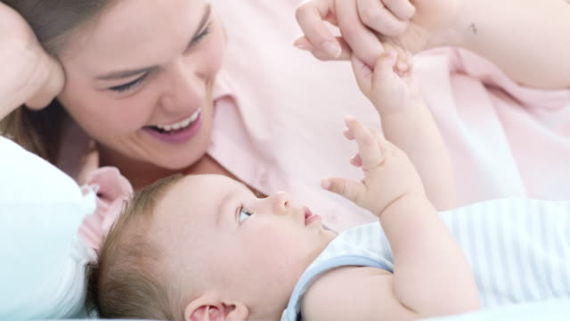 mother playing with her baby - family with one child stock videos & royalty-free footage