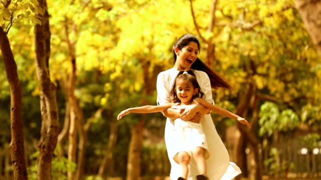 MS Mother playing with her daughter in park / Delhi, India