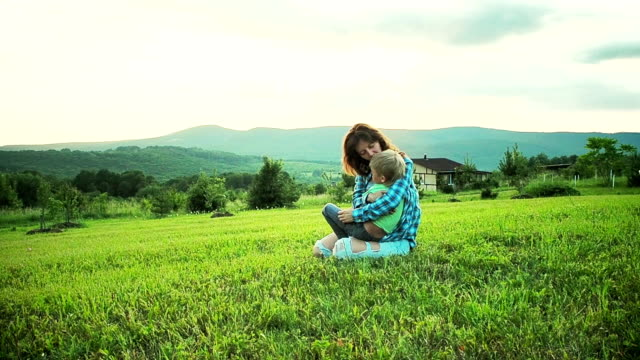 mother playing with son in meadow - baby boys stock videos and b-roll footage